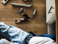 Plumber At Work In A Bathroom Plumbing Repair Service Assemble Plumbing Repair Plumbing Plumber