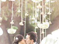 Nothing screams romance and elegance more than hanging wedding decorations.  You can hang decor over your reception tables, over a dance floor, or in tree branches.  Just keep in mind, hanging decorations can get expensive. To do it right, you need to go big and don't skimp.  Otherwise, it will look unfinished.  While it may be pricey to do hanging wedding decorations over each reception table, consider using them only above the head table which would be a more affordable splurge!