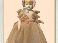 Antique or repro china doll ornaments. German doll heads.