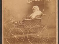 Old baby carriage and beds