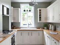 white kitchen with wooden worktop