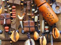 Amulets, charms, fetishes, talismans, 'gris gris' - virtually every culture has them…worn to bring luck, heal, enhance, protect or ward off evil, depending on the wearers beliefs and intentions….changing from east to west, culture to culture and person to person adding their own touch.  Even if one does not believe in their powers, they are fascinating, mesmerizing and enticing.