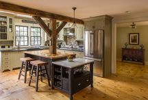 The Garvin-Weeks Farmstead / This 18th century farmhouse features period details from the home's Georgian and Craftsman eras. The kitchen and family room, constructed in the original barn connector, is a farmhouse style space with reclaimed wood timbers.