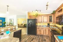 Model TNR-6563B / This 1,400 square foot bungalow style manufactured home features 2 bedrooms, 2 baths, and a den.