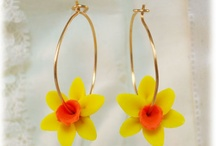 Flower Hoop Earrings / I love to wear hoop earrings so I created a collection that features my hand sculpted flowers that drop lightly from sterling silver and gold filled hoops.