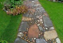 Pebble Mosaics / Pebble Mosaic ideas - things to steal from for designing a new front yard! / by Sandy Fischler