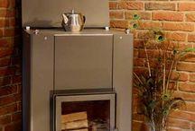 Zuhause am Kaminofen / Tipps und Erfahrungen mit einem wasserführenden Kaminofen und wie man günstig sein haus mit Holz beheizt.
