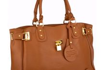 Can she have too many purses? / I don't think so... #designer purses #designer handbags #purses / by Greg DiVilbiss