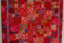 red quilts / by Carol Mercer