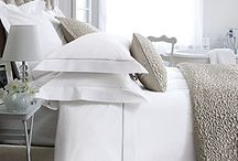 white & strip bed linen, taupe cushion