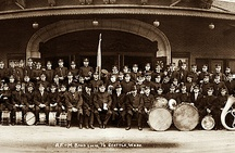 Seattle AFM Band 1913 / This is a 1913 photo of the AFM Band in front of the the Metropolitan Theatre in downtown Seattle (where the Fairmont Four Seasons is now located).  We had this photo digitally restored by Heritage Photographs just recently and it is now framed and hanging on our office walls.