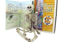 The Skeleton in the Closet: A Halloween Traditon / The Skeleton in the Closet gives treats and plays tricks!  This set includes the book and doll. Fantastic gift idea for kids and adults!! Perfect companion to your Elf on the Shelf or Mencsh on the Bench!!!