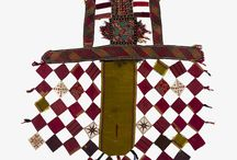 Ikat / kat chapans are stunning flowing robes for men and women out of Central Asia and Anatolia. They feature colorful and elaborate designs that date back centuries and feature the typical ikat embroideries that became a status symbol throughout both Europe and the East.