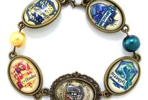 Harry Potter / Harry Potter themed jewelry. Wand necklaces, Hogwarts House rings, charm bracelets and more.