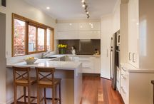 Richmond Kitchen / Designer: Michael Simpson Location: Richmond Photography by Yvonne Menegol Our clients in Richmond wanted to move their kitchen into the old dining room so they could make it larger and better use the adjoining outdoor space. The new kitchen incorporates a servery window through to the outdoor area which is perfect for entertaining. This cleverly compact kitchen also includes a broom cupboard beside the fridge and a corner walk in pantry plus so much more.