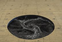 Movie Theater In Italy Has A Perpetual Black Water Whirlpool Built Into The Floor