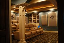 Fleur-De-Lis Theater / This home theater design was centered around the Fleur-De-Lis. It is featured and referenced on several surfaces, including the acoustic panels, wall paper, carpet and other accents.