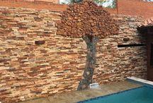 Muro en piedra para piscina del árbol de la vida