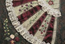 Crazy quilting and embroidered seams.