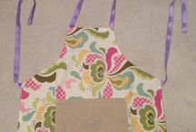 aprons and bags / Aprons I've created for kids and adults.  Bags I made using Boo Davis' pattern. Send me a message about making one just for you to buy!