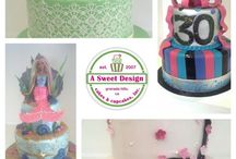 Celebration cakes / by A Sweet Design Cakes & Cupcakes, Inc