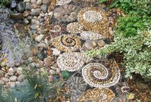 shell motif pebble paving / a private garden commission to create a series of shell inspired pebble paths winding around a garden and central pond.  Garden design by Cheri La May