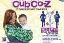 Lil' Cub Hub - Baby Carrier/Diaper Bag (Cub Co-Z) / The Award-Winning Cub Co-Z Convertible carrier is a diaper bag that converts into a sling-style baby carrier in just one zip! Two items in one -- A compact diaper bag that converts into a sling-style baby carrier in just one zip!. All of the convenient pockets are located on the outside of the bag and carrier, allowing you access to everything you need regardless of which way it's being worn.