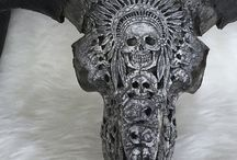 CARVED AND PAINTED  SKULLS