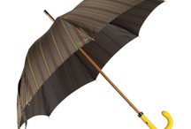 Keswick Limited Edition, Handmade Umbrella's / The Keswick umbrella is handmade in Italy, in the only place left in the western world, that still manufactures by hand. The shaft is made from a single piece of mallaca wood, making it virtually unbreakable. The handle is made from the finest leather in two colurs with contrast stitching, to complement the canopy. The canopy is attached by hand so that the panels line up, this can only be achieved when hand sown. The umbrella's are limited edition, there are only 4 of each design worldwide. / by Clements and Church Independent British tailor