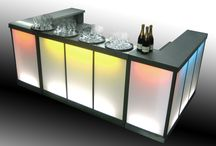 Steelite Bars / Steelite Bars are fully customisable bar units are the latest in portable bar design. The illuminated light boxes in each bar unit make available a range of options including choice of lighting and brand awareness. Our in house graphic design team can provide your ideal look. Constructed from high grade polished stainless steel, these bars look stunning in any environment. Mounted on braked castors, each single unit is 5ft in length & can be hired singly or as multi-unit installations.