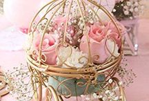 Wedding Theme Fairy-tale / Live happily ever after with a fairy-tale theme wedding, the Bride and her Prince Charming can have a magical day with enchanted roses, Princess Bridesmaids & Ball Gowns. Imagine a Castle with chandeliers, crowns and tiaras. A horse and carriage and a feast fit for a king.