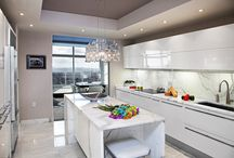 Modern NJ Kitchen with a NYC View / A modern kitchen, in Verona, NJ, with a beautiful NYC views, by Kuche+Cucina. High gloss Pedini cabinets. Calacatta white marble floors, counters and backsplash.