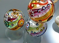 I love......glass marbles. / Actually I love all marbles..  Oops, forgot to mention paperweights..  Love them both.. / by Sandy Kohring