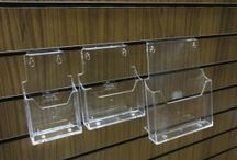 Slatwall accessories / slatwall acrylic accessories / slatwall Perspex accessories / Range of plastic and acrylic slatwall accessories- leaflet holders - shoe shelves - card display - and much more.