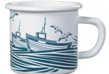 Mini Moderns - Whitby / Mini Moderns was founded by Mark and Keith who combine a love of pattern and colour with a passion for 20th-century design.The Mini Moderns Whitby collection is a set of stylish enamel home accessories named after the North Yorkshire town. Inspired by 1950s linocuts, the design features images of boats, seagulls and horizontal stripes that represent the sea, all in a washed denim colourway. Discover the collection today: