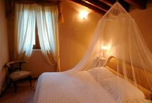 """Appartments Cascina Crocelle / The farmhouse """"Crocelle"""" has 10 apartments: 6 two-room flats (+ use of sofa bed) and 4 three-room flats, which can accommodate from 2 to 5 people.  The wine bar for wine tasting is open exclusively for our guests. A heated outdoor pool has been developed within a small olive tree grove overlooking the lake.  #gardalake #gardasee #gardameer #Agriturism #GardaLake, #lakeview, #pool, #kids #playground, #enoteca, #relax #agritur #farmhouse"""