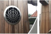 Hampton Court Palace porthole | Our Work 2017 / A set of intricate covers, laser-cut in stainless steel, designed and made for porthole windows in a new attraction in the gardens of the world-famous Hampton Court Palace.