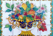 Fruit Tiles / Here you will find a variety of unique murals that are our own creations or you can submit your own custom picture for us to paint on the tiles. You will find home décor such as small tiles, plates to hang on the wall along with vases and bells for decoration (upon request) as well as larger tiles that would look stunning in an entryway, or garden.