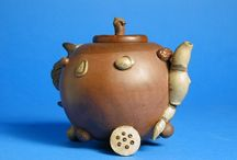 China's Favourite Pottery for Tea, Yixing Ware   July 1 – Oct 18, 2016 / The brown Yixing stoneware teapots rose to prominence with the Chinese literati of the Ming and Qing (1644-1911) dynasties who used the stoneware as their preferred vessels. Small Yixing teapots were said to be best for enhancing and retaining a tea's colour, flavour, and aroma; a fine complement to an intimate gathering of two or three friends. Some scholars commissioned Yixing potters to make pots for them embellished with a calligraphic inscription or landscape scene.