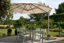 P6 Saule Umbrellas / Named for the Baltic Sun God, the award - winning Saule is a side arm umbrella , preferred because it leaves more table space for food and beverages, and offers diners an uninterrupted view. Truly an extension of the indoors, Saule performs well in inclement weather with the option of rain gutters , which securely shuttle water away from occupants. Options including incorporated heaters and LED lighting will be available later in the year.