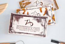 Ceramic design / Logo and business cards for sculpture studio Zbigniew Blajerski. Business cards are made of hand imprinting and glazed ceramics. Designed by Danuta Raczkowska. Handmade by Zbigniew Blajerski.