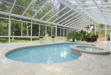 Cathedral Sun Rooms and Patio Enclosures / The dramatic use of light and space in Four Seasons cathedral sunroom designs as new dimension to a home and lifestyle.  A Four Seasons cathedral glass house features a front peaked wall that welcomes light and extends outdoor views.