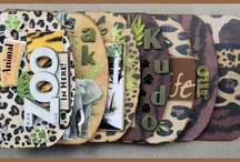 My Cricut Disney's Animal Kingdom, Safari Scrapbook Edgy Album / Disney Scrapbook Layouts: I made this shaped album using my Cricut and their Design Studio software. I used photos from our trips to the Saffari Ride at the Animal Kingdom at Disney World. / by Heather Gibbs
