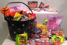 Halloween / Each package includes a decorative pail filled with tons of Halloween fun.  Select a trick OR treat package for your special goblin.  The Trick Package includes an assortment of games to offer a variety of fun.  The Treat package includes an assortment of sweets and treats.  OR pick the package that includes a little bit of both.
