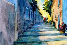 Ulica - street / Na nástenke sú umiestnené diela maliarov s témou ULICA - STREET