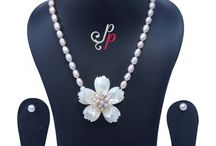 Pretty Dark Pink Pearl Necklace in Mother of Pearl Pendant at Rs.2,950
