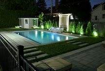 Plantenance - Two doors down / Modern backyard with concrete pool a waterfeature, integrated glass fence. Steps with integrated planters bring us down to a dinning and lounge area on ground level.