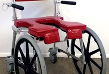 (SP) COMMODE 'N SHOWER CHAIR - SELF-PROPEL / The Go-Anywhere Commode 'n Shower Chair SP® is a commode/shower wheelchair that has 20″-diameter wheels which may be mounted on either the front OR rear of the chair.