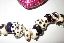 Beads with sterling silver grommets