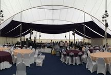 """Wedding - Canopy over dance floor / The Wedding with 700 guests, and due to the high number the couple choose a large Super Marquee which specialised in large wedding parties. The wedding was a daytime affair and they wanted to 'darken"""" the area above the dance floor. To do so we sewed purple fabric into a large piece of 12m wide x 25m length and created this canopy."""